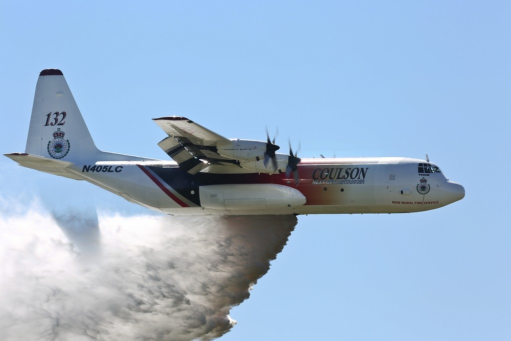 'Thor', a C-130 Hercules contracted to the NSW Government to assist in fighting bushfires dispenses water during a demonstration over the Rickaby's drop zone near RAAF Base Richmond. *** Local Caption *** RAAF Base Richmond will be used to provide airfield support services to Large Air Tanker and Very Large Air Tanker aircraft contracted to the New South Wales (NSW) Government from 01 September 2015 to 20 January 2015, assisting with NSW Rural Fire Service (RFS) efforts to combat bushfires. Defence is providing a number of services including aircraft parking and security, access to fuel and refuelling facilities, equipment storage, use of resources including water, aircrew office space, and meals and accommodation for up to 20 people, as required. Facilitating the aircraft at RAAF Base Richmond is intended to maximise aircraft utility and provide access to all areas of NSW in the event of a bushfire emergency. State and Territory Governments have primary responsibility for the protection of life, property and the environment, and for coordinating and planning an emergency response or recovery within their jurisdictions. Ground-based and aerial bush fire fighting is a highly specialised field that requires equipment and training that, in general, Defence does not possess. RAAF Base Richmond will be used to provide airfield support services to Large Air Tanker and Very Large Air Tanker aircraft contracted to the New South Wales (NSW) Government from 01 September 2015 to 20 January 2016, assisting with NSW Rural Fire Service (RFS) efforts to combat bushfires. Defence is providing a number of services including aircraft parking and security, access to fuel and refuelling facilities, equipment storage, use of resources including water, aircrew office space, and meals and accommodation for up to 20 people, as required. Facilitating the aircraft at RAAF Base Richmond is intended to maximise aircraft utility and provide access to all areas of NSW in the event of a bushfire emergency.